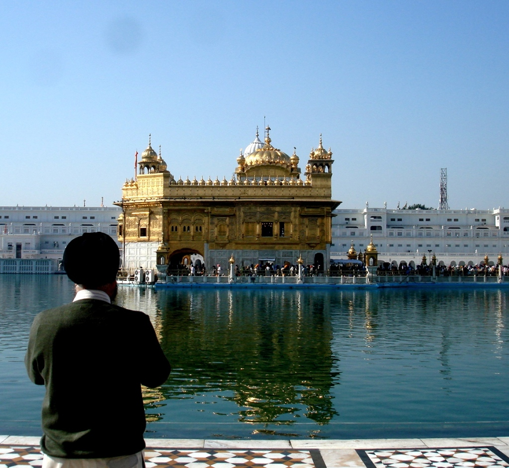 A follower offering prayers to the Golden Temple