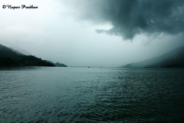 Dark clouds approaching the vast Phewa Lake